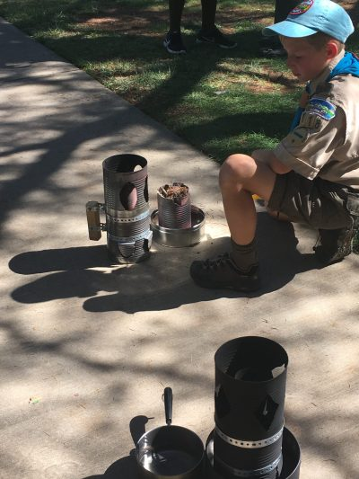 Levi Martin, 11, the only scout to take on building a cookstove without a partner, waits for the flames so he can boil his water. Levi, the cook who tried his hand at frying the egg pictured below, won third place in the cook-off.